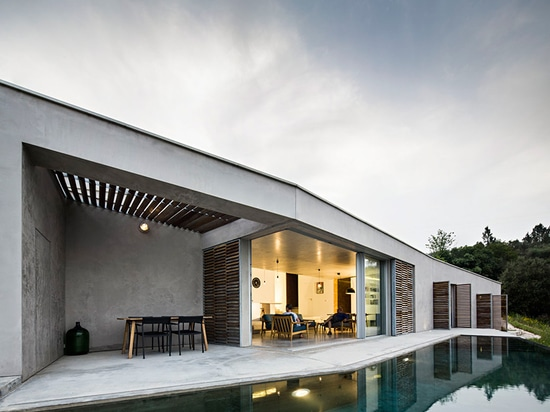 cooking, dining, and living amenities spill onto an outdoor terrace