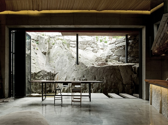 a terrace looks out into the jagged mountains that 'dayang sanghoi' stands atop