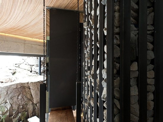 charcoal and stone enclosure
