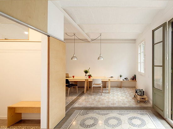 the 1930s apartment is located in barcelona's eixample district
