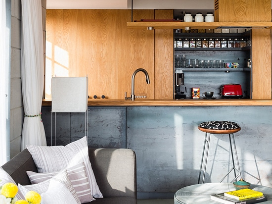 the 7th floor apartment features an adaptable and open arrangement