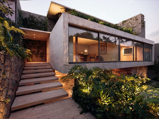 Don't let the house's powerfully geometric exterior fool you; the interior was designed to be warm and homely