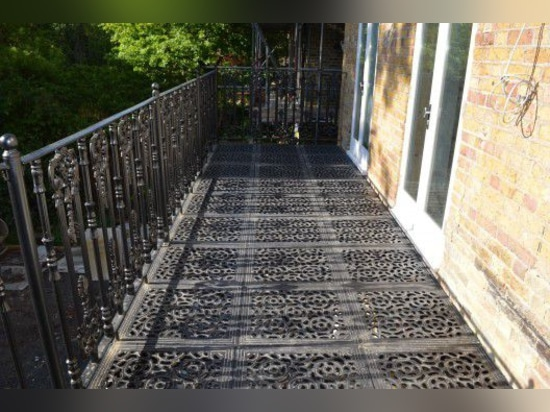 NEW: entrance balcony with bars by British Spirals & Castings