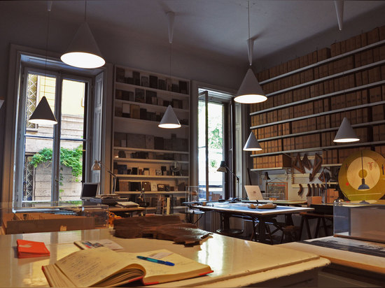 One room of the studio houses Castiglioni's technical drawing tables, still in use by the foundation