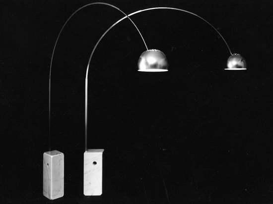 Castiglioni made a hole through the 65kg marble base of his now famous 'Arco' light, so it could be carried by two men with a rolling pin or a broom handle