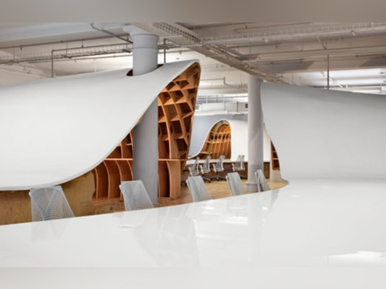 "Clive Wilkinson's office for The Barbarian Group is ""one huge table through a room"""