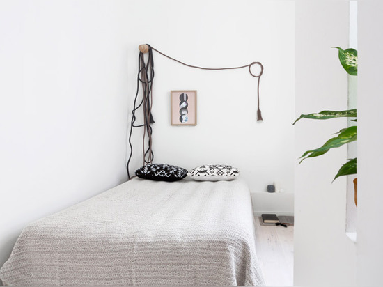 Sarah Van Peteghem restyles Berlin apartment with woollen lamps and cables