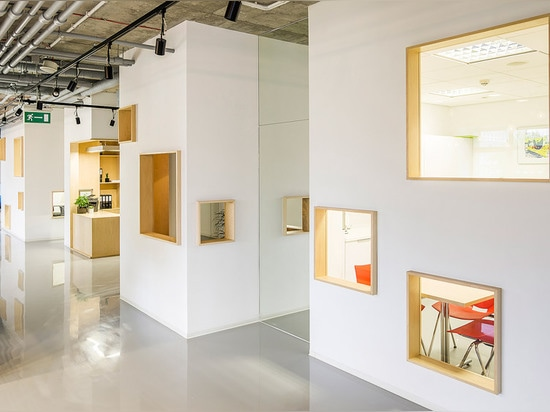 MFRMGR creates house-like cubicles with windows inside a Polish office