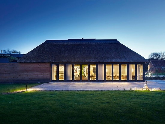 Softroom converts thatched-roof pub into contemporary restaurant and cookery school