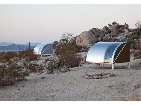 People are camping inside these pods in the desert