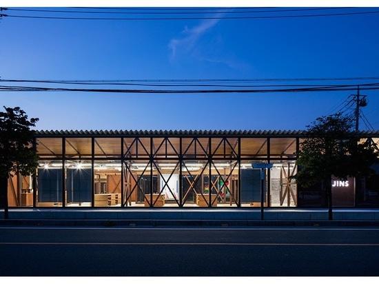 schemata architects remove façade to reveal eyewear brand's timber interior
