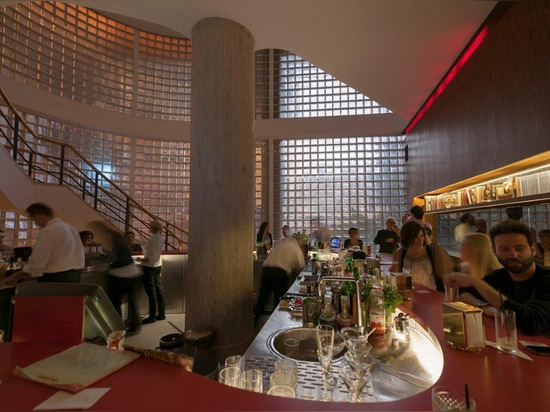 the bar curves around the large space achieving an intimate and sociable setting