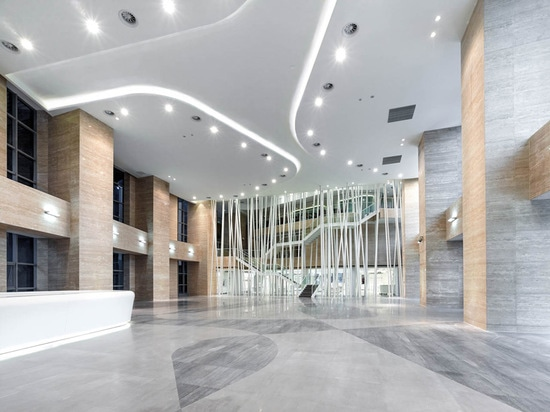 the 12m high lobby invites visitors to the southwest corner of shop and aimer's museum
