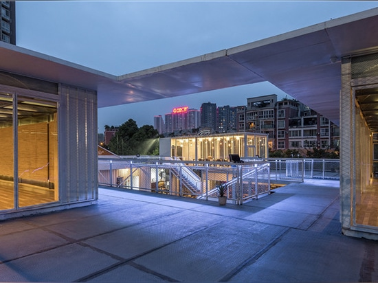 the black box gym by epos architects is defined by metal + glass