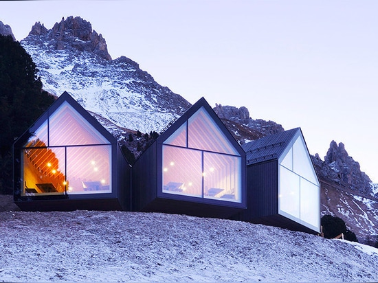 Stunning wooden Oberholz Mountain Hut branches out of the mountainside like a fallen tree