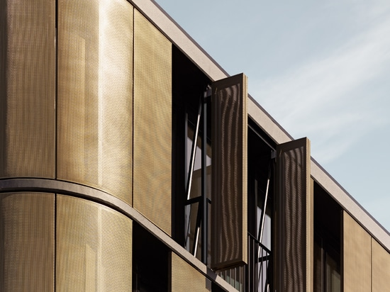 Bronze-coloured solar protection mesh unites two worlds