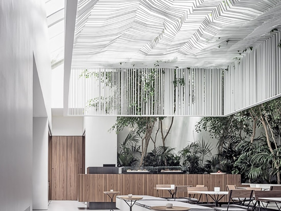 kois associated architects hang sculptural ceiling canopy over museum café in athens