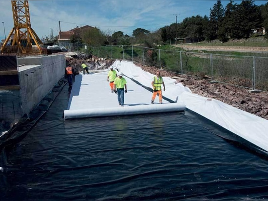 laying the geomembrane and geotextile