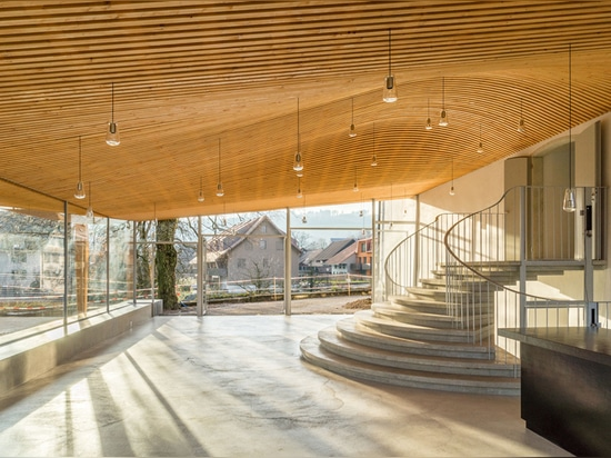 gian salis adds light-filled foyer to historic church in switzerland