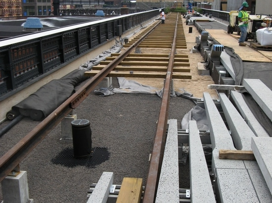 Installation of the green roof build-up under the rails.