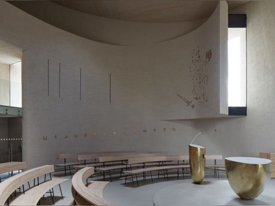 Light glides softly inside this cylindrical modern church in the Czech Republic