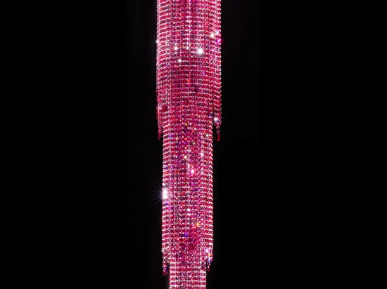 Red-pink vibrating waterfall of crystals