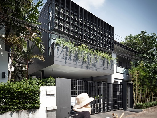 anonym studio turns old living estate in bangkok into a vibrant flower cage house