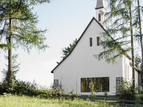 messner architects situates its newly renovated saint joseph chapel in the alpine woods