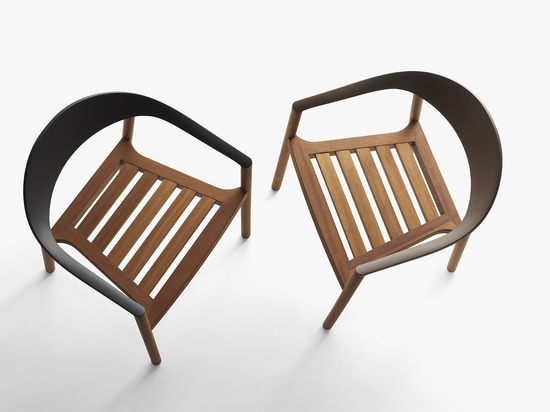 PLANK - MONZA armchair outdoor version. Massive iroko wooden structure, oil treated. Backrest in polypropylene in the colours black and terra brown. Outdoor and Indoor use.