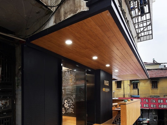 This New Coffee Shop Was Inserted In An Older Apartment Building In China