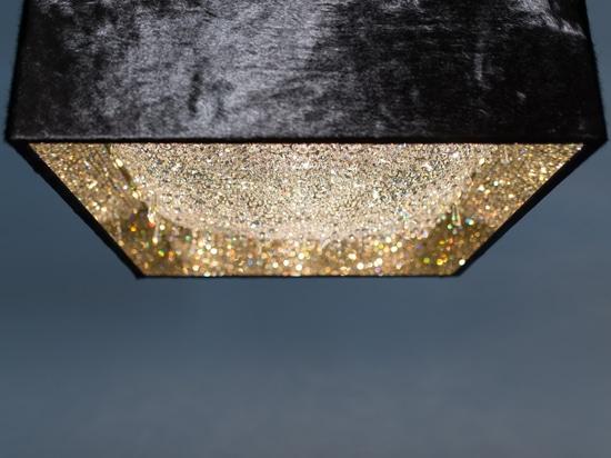 Deep Sky crystal chandelier with black cowhide