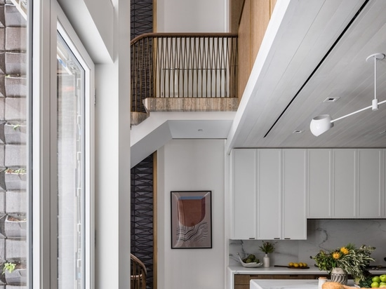 MKCA overhauls Upper East Side townhouse with custom staircase and furniture
