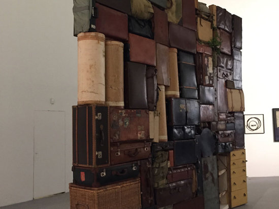 """Fabio Mauri's """"The Wailing Wall"""" in the entrance space to the Central Pavilion, part of series inspired by images of the piled, discarded suitcases of concentration camp victims."""