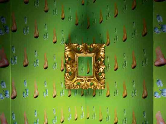 'Nose/Popcorn – Yellow/Green' wallpaper by John Baldessari with 17th-century Italian pierced lobate leaf and volute motif frame, from Gill & Lagodich Gallery. Photography: Anthony Cotsifas; Produce...