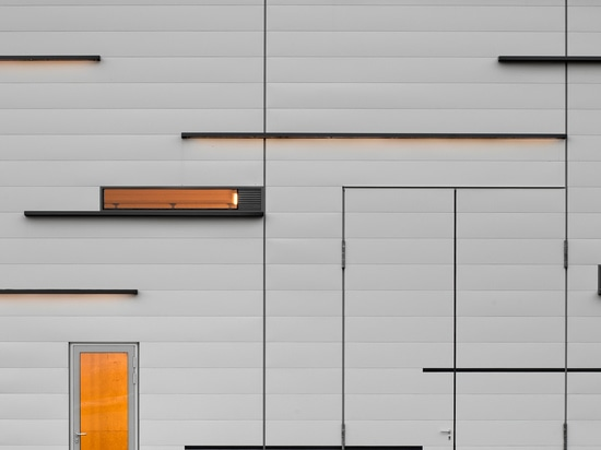 Subtle composition: dark grey coated horizontal elements, joints, narrow window openings