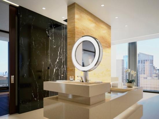 luxury bathrooms overlook the city skyline