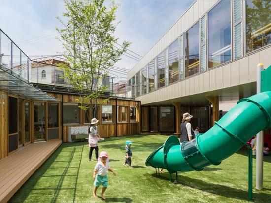 tadashi suga articulates takeno kindergarten around a courtyard playground