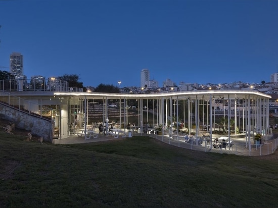 "Solar-powered glass cafe overlooks a ""green lung"" in Jerusalem"