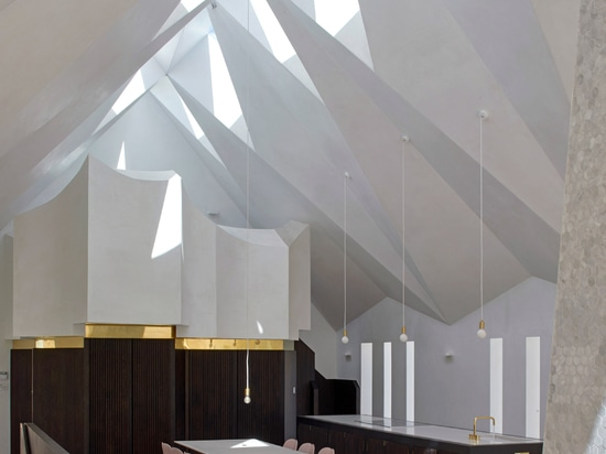 Craftworks inserts home with faceted modern gothic roof into abandoned chapel