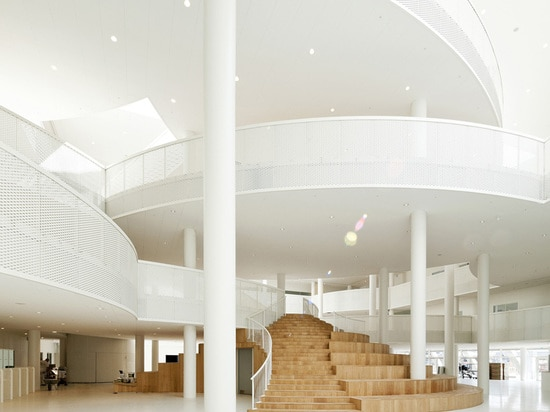 rounded shapes form a series of balconies and platforms with shifting overlaps across the atrium