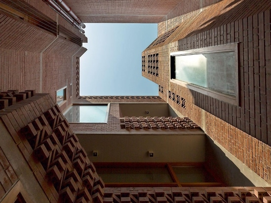 A small interior courtyard brings light and ventilation to the heart of the home, its intricate brickwork creating dramatic shadows. Photography: Saurabh Suryan and Lokesh Dang