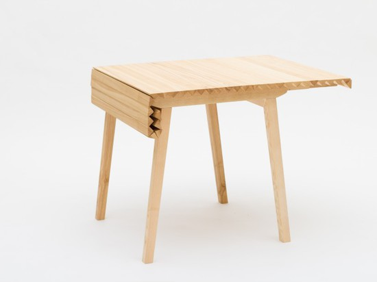 A WOODEN TABLE THAT FOLDS LIKE CLOTH