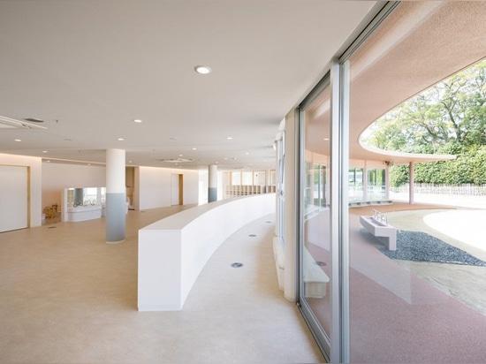 ryuji fujimura tops subaru nursery school in japan with curved concrete roof