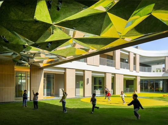 kindergarten complex in shanghai by office mass is shaped like the infinity symbol