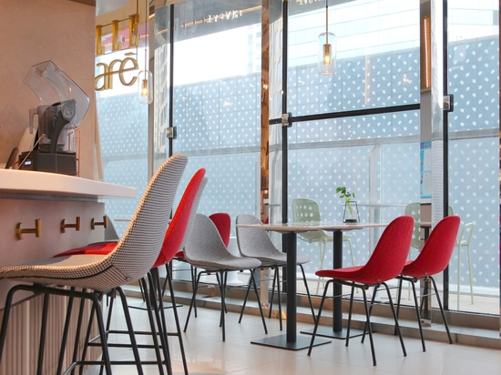 Ta Up Chairs by TOOU, surrounded by the colored atmosphere of the Elle Café in Shanghai.