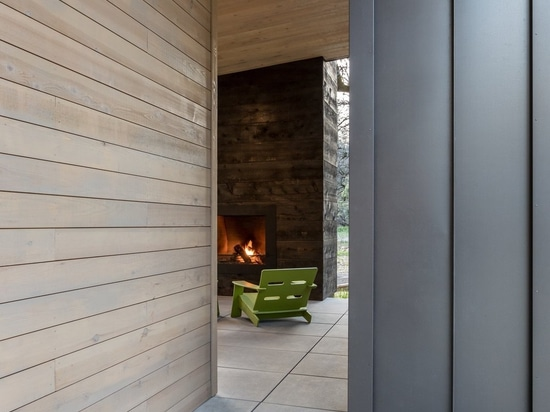 Breen selected 24-inch by 60-inch large-scale pavers for the walkway to the entrance and 24-inch by 48-inch pedestal set-roof pavers on the patio, both in French Gray.