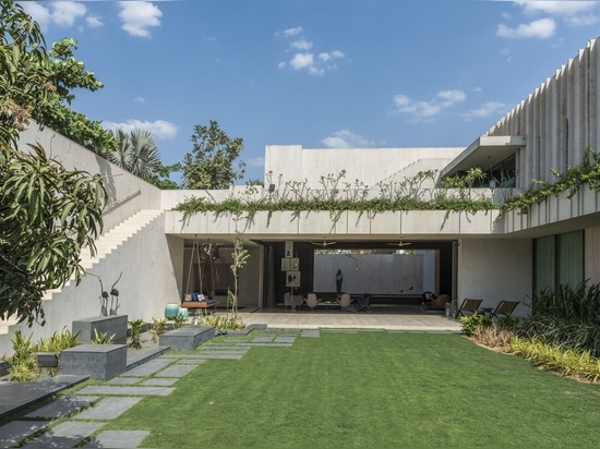Lush Gardens Soften This Rugged Stone Residence in India