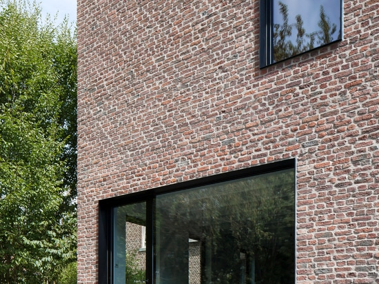 Belgian bottling house converted into family home by Architecture Cotugno Thiry