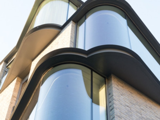 Protruding Glass Windows Add Interest To This New Building In London