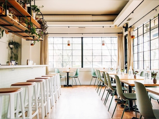 Bar West in Portland, featuring TOOU Bar stools with upholstered seat.